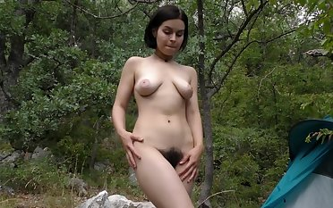 Outdoor amateur plays with her bush in kinky solo