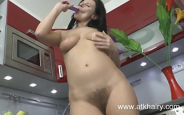 Hairy MILF Jana uses a toy on her natural pussy