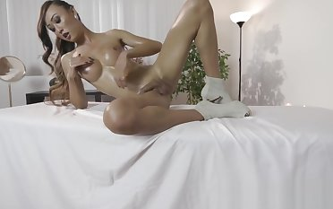 Oiled up Asian ghetto-blaster gets naked and rubs her thick cock