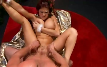 Busty nympho rides fat cock keenly near the Xmas night before tree
